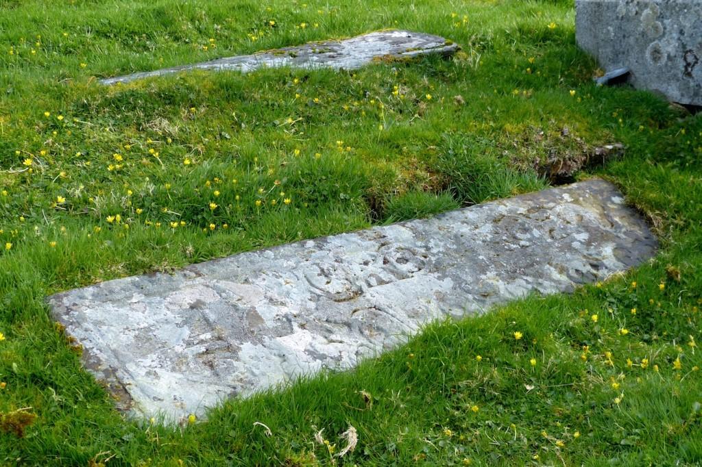 The two Maciain grave-slabs near the church entrance.